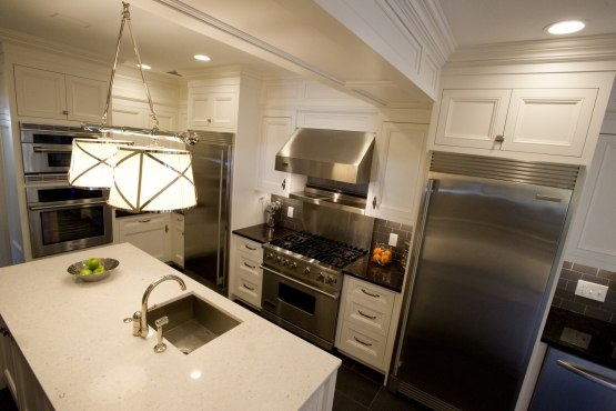 Chef's island located across from Viking range, full size refrigerator, full size freezer and double ovens.