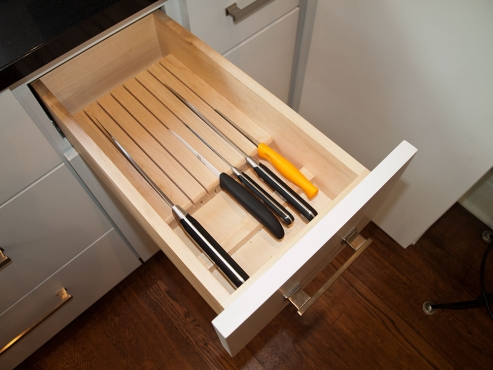A custom knife drawer is included in the solid, maple cabinets with soft-close hinges and slides and dovetailed drawers.
