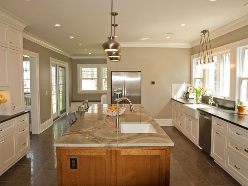 The main kitchen area leads into the laundry and mudroom.