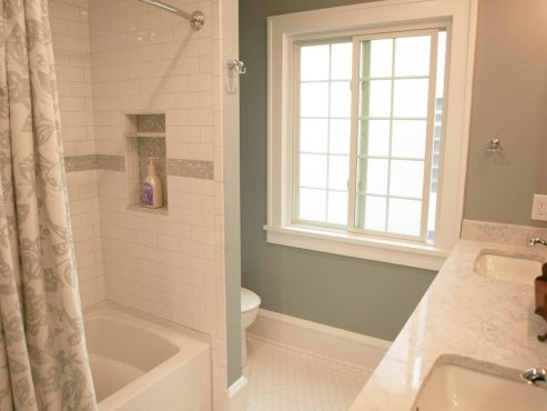 The tub was relocated to the interior wall of the bathroom, creating an alcove for the toilet and allowing for the installation of an alcove tub.