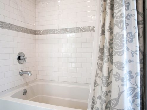 "The 3x6"" white subway tile created a neutral backdrop for the glass and stainless mosaic border."