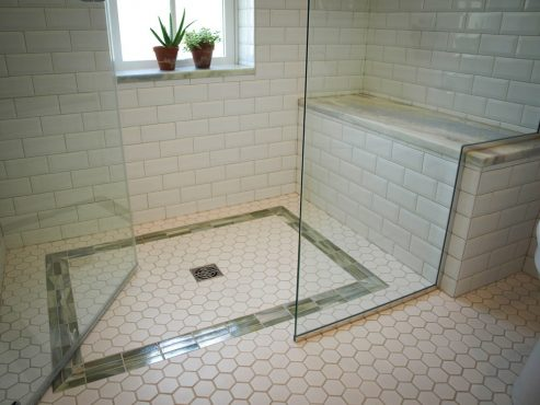 Custom glass shower enclosure with door that swings in or out!