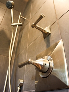 The elegant brushed nickel shower fixtures brighten the shower.