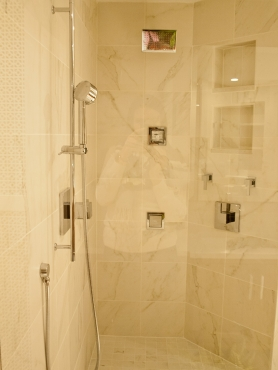 This Shaker Heights shower features fixtures from Grohe. Two body jets, a shower head and a handheld shower are all controlled with separate volume and temperature controls. Water pressure was a concern with the amount of output fixtures, so a larger diameter water line was used to accommodate the amount of water output.