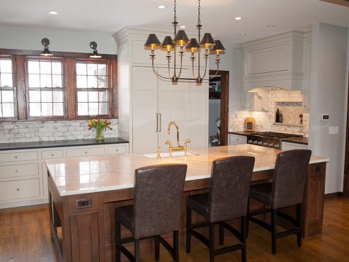 The Hudson Valley Jasper chandelier adds warmth and character to the newly renovated space, seamlessly integrating the kitchen into the rest of the first floor.