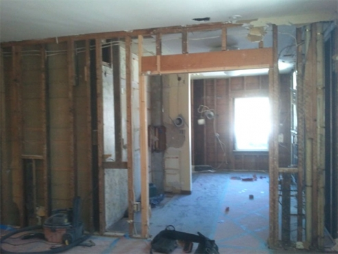 Small load-bearing wall and steam heat line to be removed to create new galley area of kitchen.