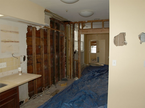 Partially gutted galley kitchen.