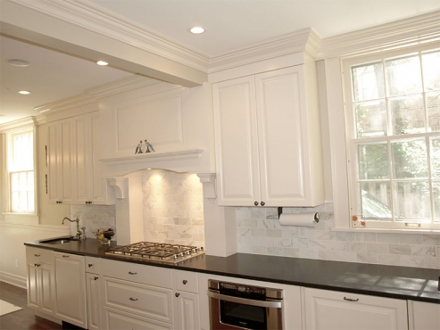 Newly remodeled (galley section) with granite countertops and custom marble backsplash built by The Beard Group.