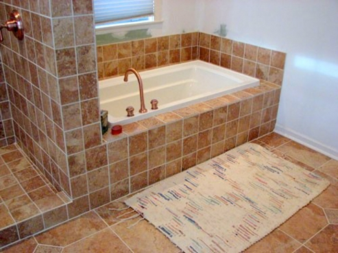 Cleveland Heights, OH Bathroom Remodeled by The Beard Group. Custom tile tub and shower designed and installed.