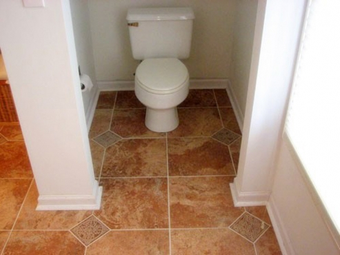 Bathroom Remodel with separate toilet area and custom tile flooring installed in Cleveland Hgts. OH