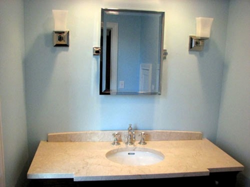 New Lighting installation and custom countertop in University Hghts. OH bathroom renovation