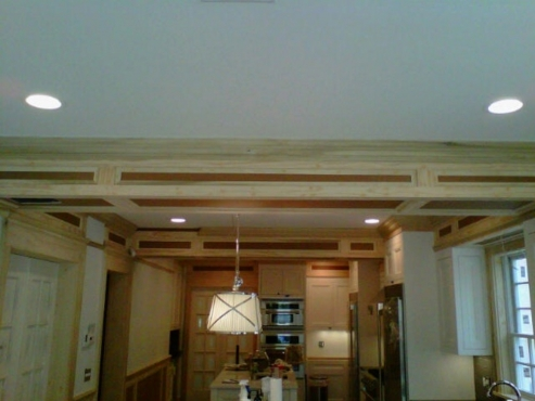 Once painted, the custom woodwork will look like part of the custom built cabinetry.