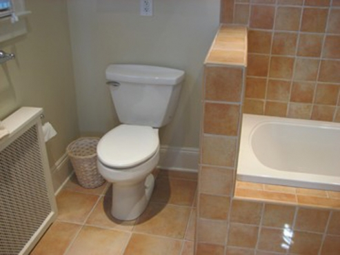 Remodeled bathroom with tile flooring, shower and tub in Shaker Heights, OH