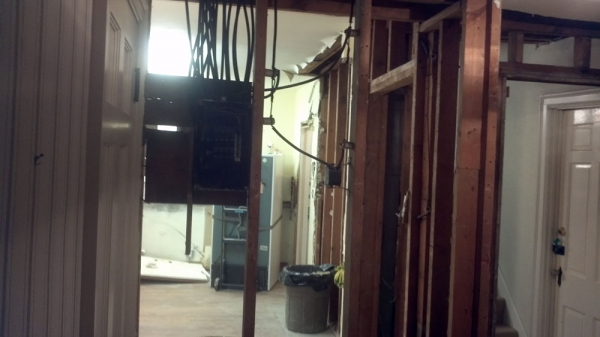 Electrical panel and load bearing framing to be removed.