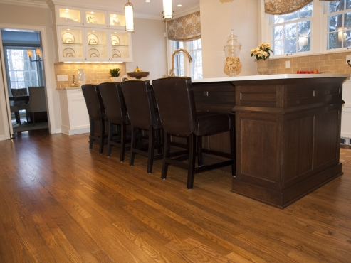 Salvaged oak flooring from original galley kitchen. The Beard Group repaired some areas while bringing the majority of the oak back to life.