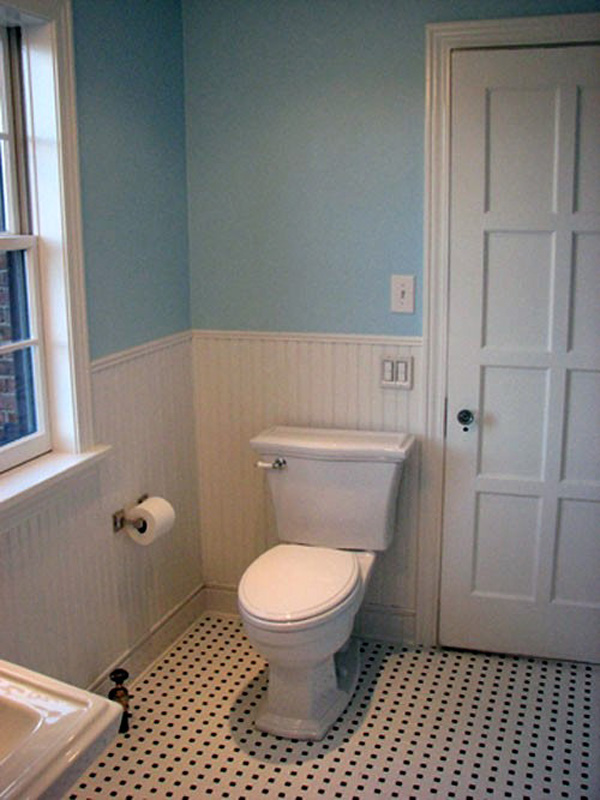 Custom wainscoting instal and new bathroom tile flooring.