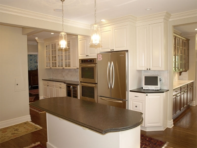 Glass doors on upper cabinets pair well with wine cooler below.