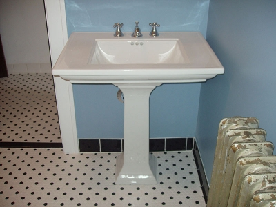 Remodeled bathroom with new tile flooring installed