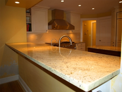 Granite countertops add the final touch to this new pass through breakfast bar.
