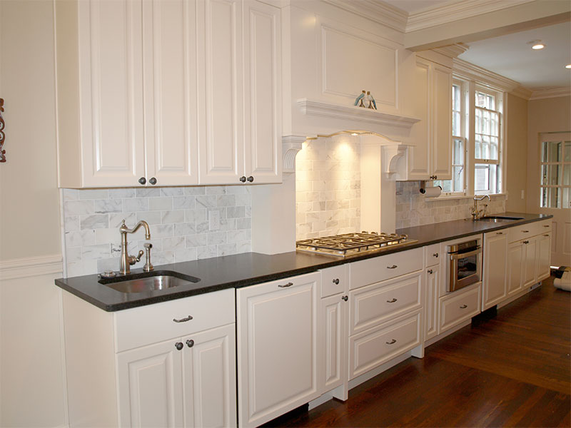 The Beard Group cut large pieces of flooring marble into smaller 3 x 5 inch pieces for the backsplash.