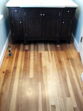 Custom cabinet and wood flooring installation in this Univerity Heights, OH bathroom repair