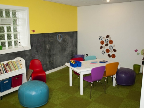 A children's art and reading corner. Chalkboard paint was used on the walls.