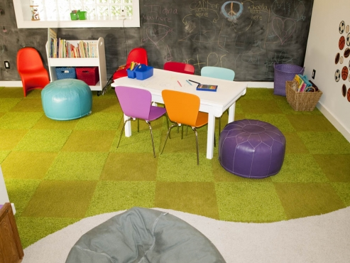 The carpet tiles were installed with a curved transition to blend the two areas of the space.
