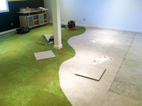 During the installation of the carpet tiles.