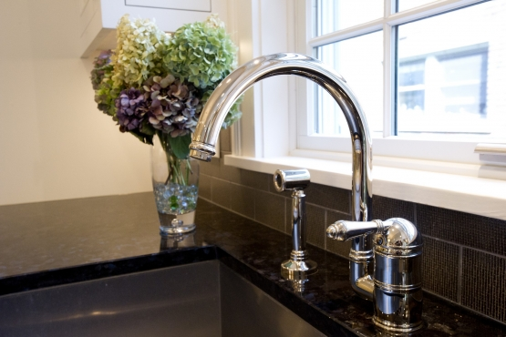 Main under-mount sink with polished chrome faucet.