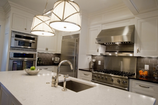 White Quartz countertops allow you to spill a little red wine and simply clean it up in the morning, they won't stain. A great choice for a kitchen that is perfect for entertaining.
