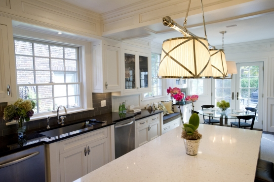 A very modern kitchen with a flare of traditional can be seen in the custom woodwork detail.