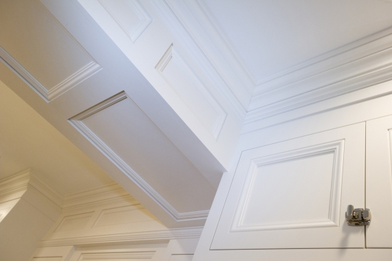 """Solid maple custom cabinets were installed first, then multi-stage crown moulding was installed. Everything was then spray-painted with a high-grade laquer to achieve an on site """"factory finish"""" that is absolutely seamless. Be sure to see the before/during pictures of this woodwork."""