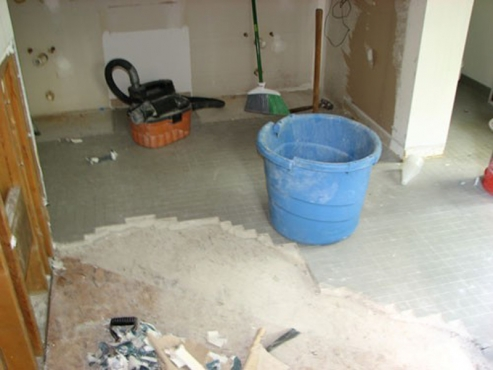 Bathroom Remodeling with new drywall installed and sub-flooring by Beard Group in Cleveland Heights, OH