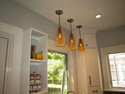 The Crate and Barrel bamboo pendants soften the sleek space.