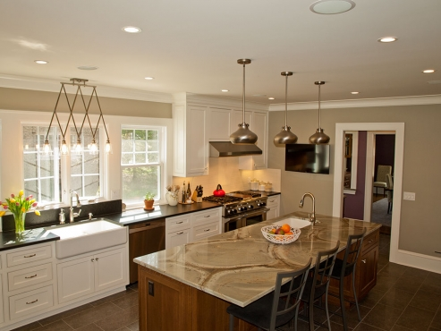 The new kitchen design features custom cabinetry, a large island and plenty of counter space, providing ample room for meal prep and entertaining.