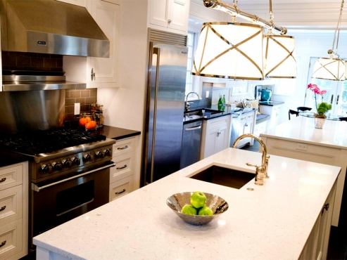 Countertops! White quartz on the islands with black granite on the perimeter. A nice alternative to two-toned cabinetry. This allows for continuity amongst cabinetry while still creating some visual tension in the space.