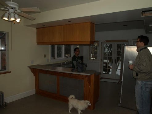 Two large radiators to be removed concealed beneath current bar area countertop.