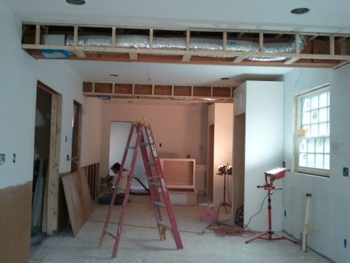 Installation of HVAC duct work, drywall and MDO board.