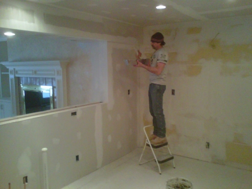 Installing new drywall around new breakfast bar opening.