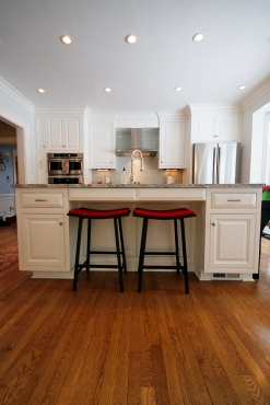 This custom Shaker Heights kitchen was formerly a dining room.  This project was a total layout change for the first floor.  Dimmable recessed lighting provides ample lighting for the large space.