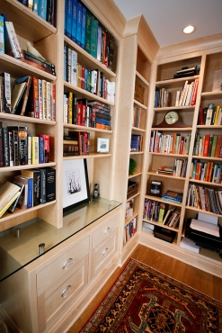 The customer calls this room her cozy room.  It is just off the kitchen and is a space to read and relax.  Custom bookshelves with a floating desk constructed from tempered glass line the back wall.  This room was formerly the breakfast room off of the old kitchen.