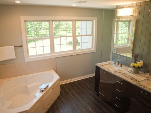 The original windows were small and outdated. New windows were replaced and expanded to give the homeowners a better view of their expansive property.
