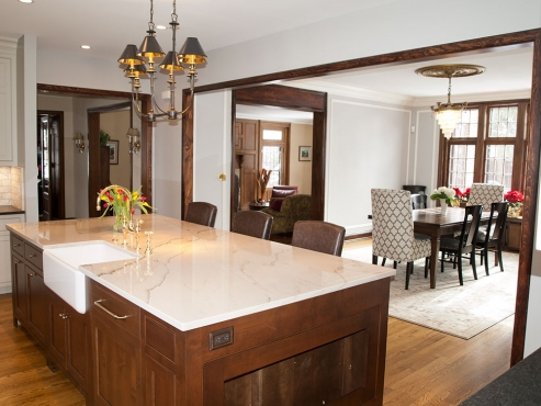 The wall between the original kitchen and dining room was removed, creating an open concept kitchen/dining area, great for entertaining.
