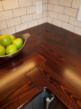 The dark, wood countertops were sourced from Reclaimed Cleveland/Rustbelt Reclamation.