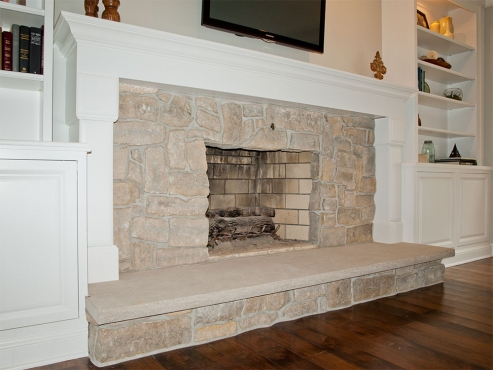 The mantel was custom designed for the new fireplace and integrates seamlessly with the coordinating built-ins and traditional style of the home.