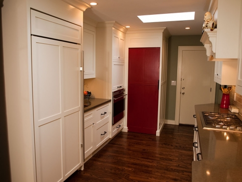 Wall oven and hide away microwave cabinet located immediately to the right of the prep sink.