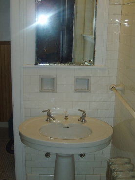 Old and outdated bathroom in Cleveland Hghts. Ohio in need of renovations by The Beard Group