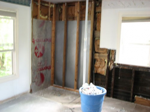 Bathroom Renovation with insulation and stud repair by The Beard Group in Cleveland Heights Ohio