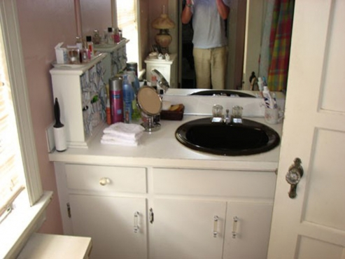 Outdated and cramped bathroom in University Heights, Ohio before the Beard Group renovation