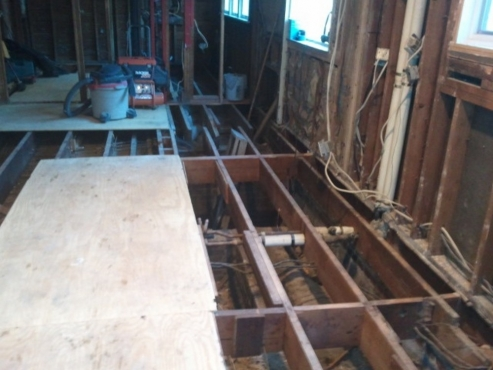 Sub-floor removed in order to level existing floor framing. This home has suffered serious settling issues…